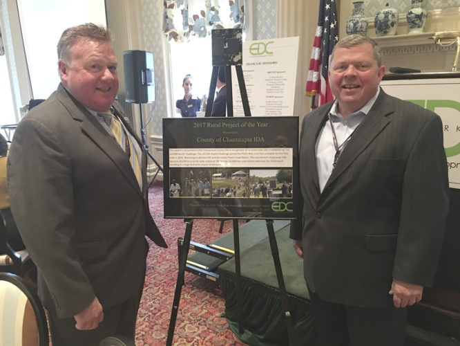 Submitted Photo Pictured from left: Kevin Sanvidge, CCIDA administrative director/CEO, and Richard Dixon, CCIDA chief financial officer, accept the 2017 Rural Project of the Year Award at NYSEDC's annual meeting in Cooperstown.