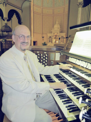 Submitted Photo: Brian Bogey is pictured at the organ in Jamestown First Lutheran Church. He will be part of a organ/choral concert on June 11 at the church.