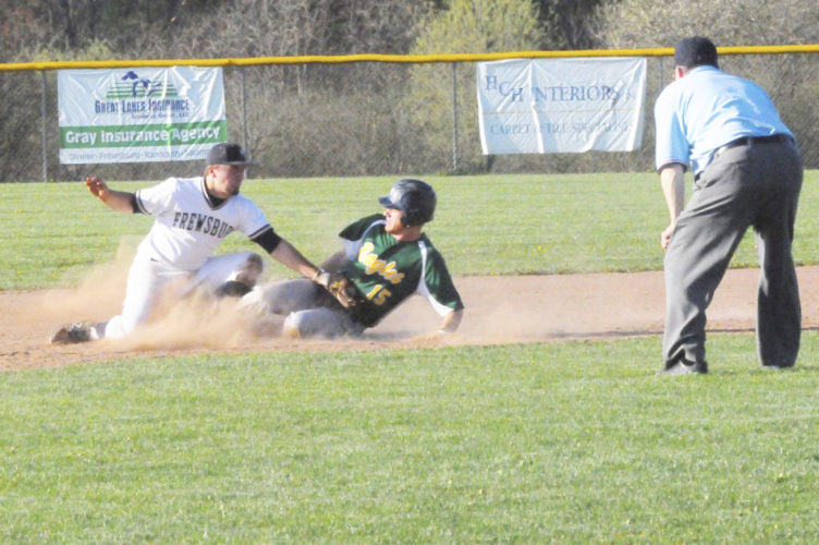File Photo North Collins' Harley Mehnert slides safely under the tag of Frewsburg second baseman Mark Mammoser during a baseball game at the Robert H. Jackson Sports Complex in Frewsburg.