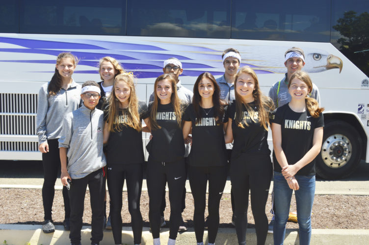 OBSERVER Photo by Jeremy Izzio: Pictured are local track and field athletes boarding the bus to Union Endicott High School for the New York State Public High School Athletic Association Track and Field Meet. They are, in front, from left, Dunkirk's Anthony Ruiz, Silver Creek's Jaylah Cossin, Emma Seiders, Grace Restivo and Kylie Procknal. In back are Dunkirk's Emilee Hanlon, Fredonia's Lydia Lanski, Dunkirk's Nelson Estrada-Cruz, Mike Deland and Chris Michalski.