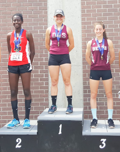 Submitted Photo Pictured at the top of the podium is Dunkirk's Emilee Hanlon, who took first place for Division 2 in the New York State Public High School Athletic Association Track and Field Meet held at Union-Endicott High School Saturday.
