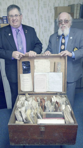Submitted Photo Richard Newton (left) and Jim Stoll display archives of Forest Lodge. The wooden chest full of membership and financial documents was retrieved from the ruins of the old lodge hall at 16 West Main Street, after that section of the Fredonia's business district was destroyed in an early morning blaze on February 28, 1973.  According to a front-page article published in the Observer, damage from the flames was estimated at nearly $1 million. The fire reportedly broke out shortly before 2 a.m. in the kitchen of the Village Squire Restaurant at 22 West Main Street.