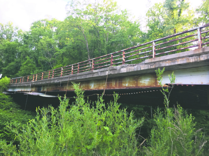 OBSERVERPhoto by Andrew David Kuczkowski The bridge that crosses Clear Creek, south of Lenox Road, has met Western New York's Mother Nature as noticeable rust accrues.
