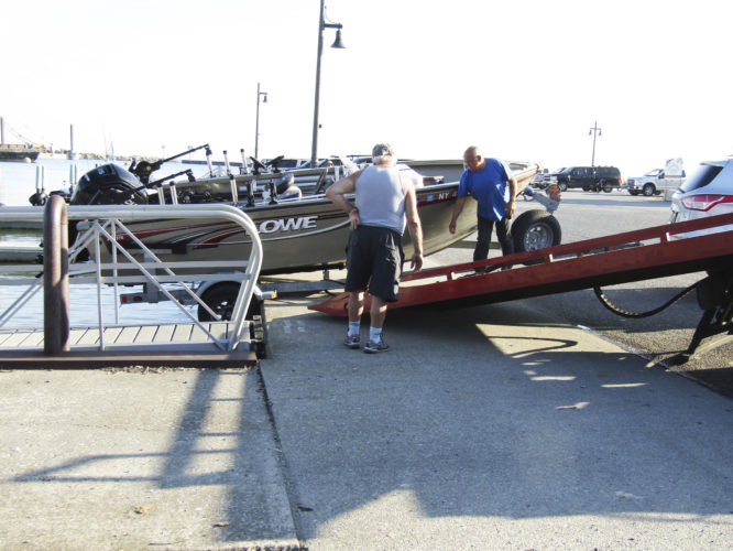 OBSERVER Photos by Gene Pauszek This lone angler had a boat trailer mishap at Barcelona when he tried to launch his boat at the wrong spot, where there was no boat launch, on Wednesday. No one was injured!