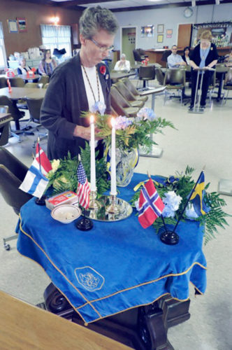 Submitted Photo The Thule Lodge held its Memorial Service to remember those members and associates who have died in the last year. Vice Chairman Susan Washington Sipos, in the background, read the list of names, and Chaplain Diane K. Shaw placed a carnation on the altar in memory.