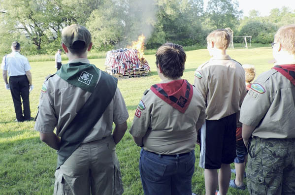 Submitted Photo Members of the Cassadaga American Legion Post 1280 and members of Boy Scout Troop 219 stood at attention during the annual American Flag ceremony held in Cassadaga at the Legion Picnic Grounds.