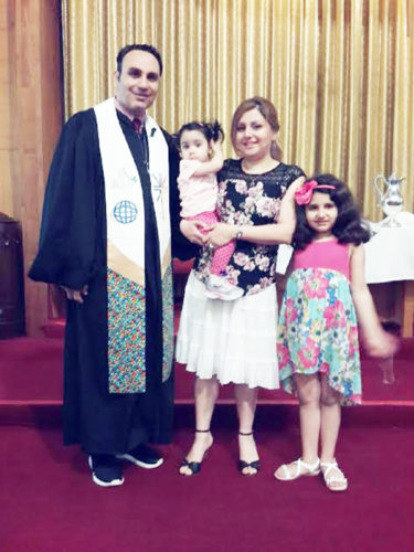 Submitted Photo First United Presbyterian Church in Dunkirk has a new pastor. Rev. Rami Al Maqdasi arrived in Dunkirk via Buffalo after leaving his native Iraq. The pastor is pictured with his wife, Raya, who is holding their daughter Lisa and seven-year-old Marilyn.