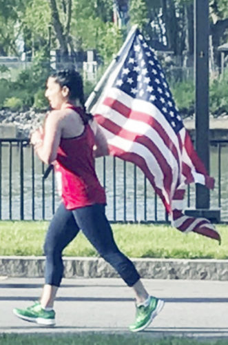 Submitted Photo Former Dunkirk resident Nina Bautista Lynch running in the Buffalo Marathon 2017.