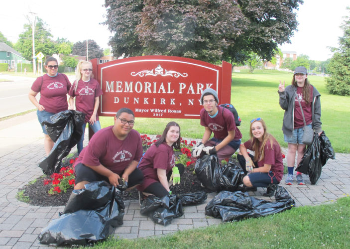 OBSERVER Photo by Nicole Gugino A group of Dunkirk seniors pose during their cleanup of Memorial Park Wednesday during Senior Sweep.