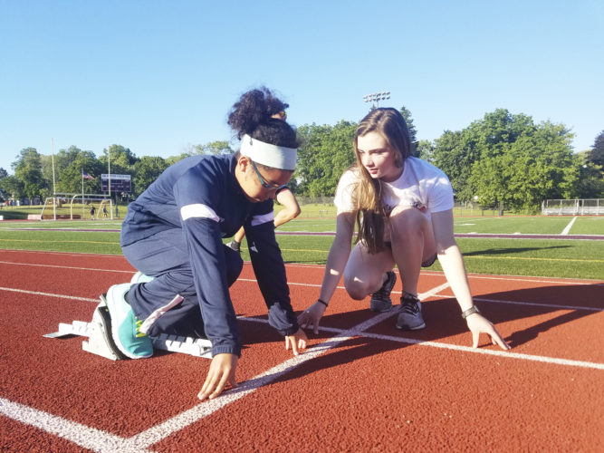 OBSERVER Photo by Jared Hill Pictured is Gracie Conlan, age 11, of Frewsburg (left) being instructed by Silver Creek's Hannah Seiders from the starting blocks for Chautauqua Jets club track and field program. The Jets goal is to expose Chautauqua County athletes to the Junior Olympic circuit, so those athletes may be more eligible for athletic scholarships.