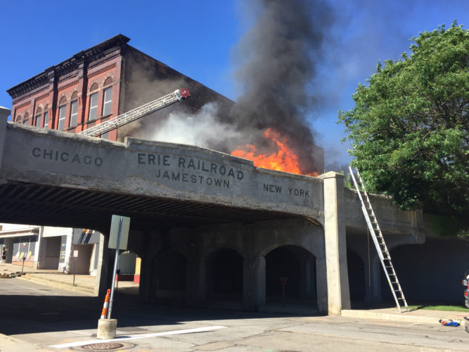 Photo by A.J. Rao Jamestown and Falconer firefighters were called to the Arcade Building in downtown Jamestown on Wednesday around 4 p.m. to battle a blaze. Firefighters were busy at work for nearly two hours. An investigation into the cause of the fire is underway.
