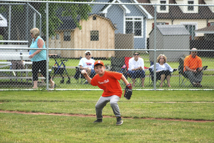 OBSERVER Photos by Andrew David Kuczkowski: Dunkirk Little League's Moose Club and Local 2693 faced off at Wright Park on Thursday. Local 2693's Ryan McFarland runs to first base as Moose Club's Dennis Keppel fields the one-bouncer.