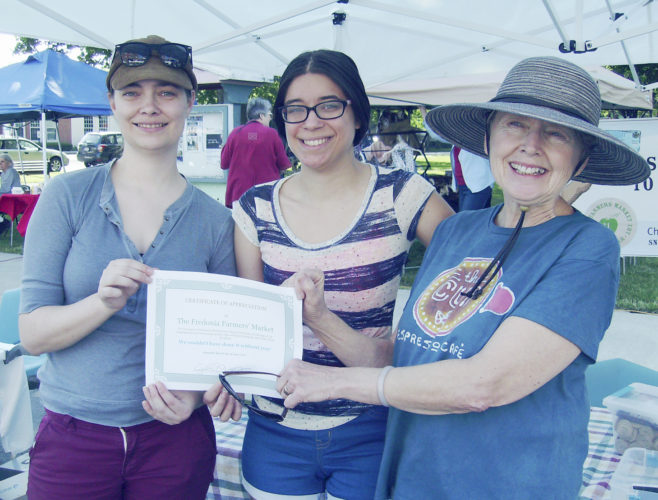 Submitted Photo: The Fredonia Farmers' Market recently received a certificate of appreciation from the Fredonia Presbyterian Church to recognize the Market's support of the church's sale of Fair Trade food. Pictured are: Anneliese Bruegel, Farmers' Market manager, with Linnea Carlson, and Cindy Rechlin of the Fredonia Presbyterian Church.