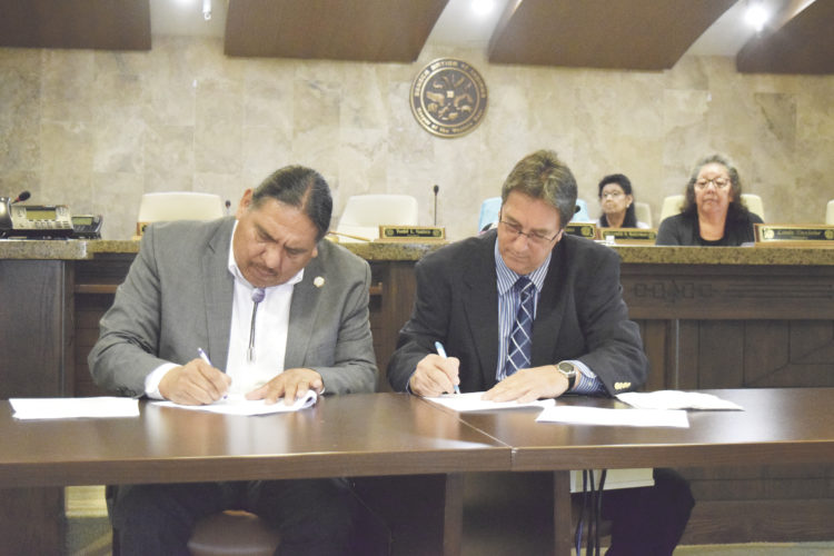 OBSERVER Photo by Andrew David Kuczkowski Seneca Nation of Indians President Todd Gates, left, signs the water agreement to deliver water to the hamlet of Lawtons in North Collins with North Collins Town Supervisor John Tobia signing the agreement as well.