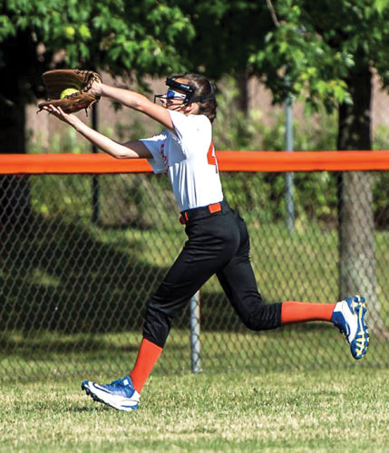 OBSERVER Photo by Ron Szot Fredonia leftfielder, Sarah Davis, makes a catch towards the fence in a little league softball All-Stars game against Dunkirk.