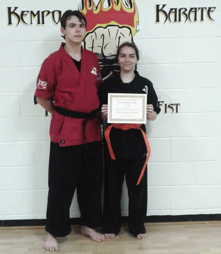 Submitted Photo: Two mixed-martial artist had their belt advancement ceremony on Wednesday at the Family Martial Arts Center and the Kempo Karate Organization. Sensei Tim Smith, left, and sempei Alex Cornell both advanced.