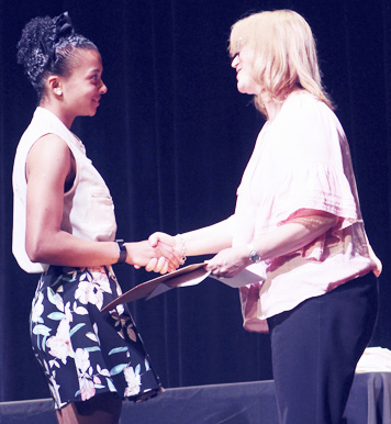 Submitted Photo Sydney Swan (left) is presented the first Fredonia-Pomfret Democratic Association Joe Sweeny Scholarship by Christine Starks.