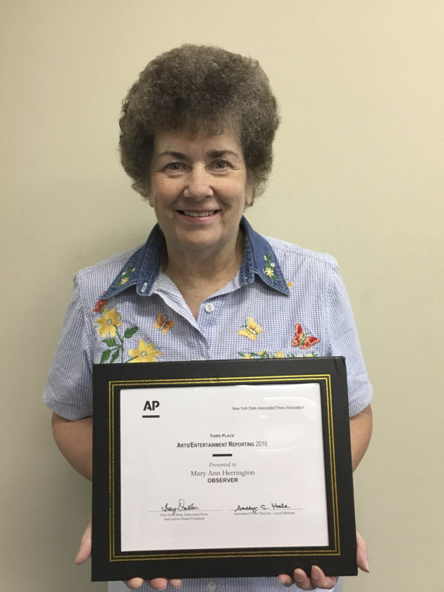 OBSERVER Photo Mary Ann Herrington is pictured with her 2016 New York State Associated Press Award.