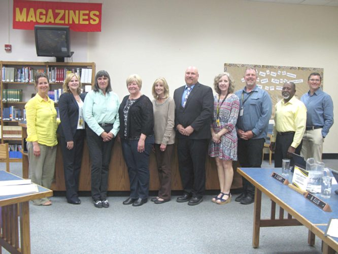 OBSERVERPhoto by Amanda Dedie. The Forestville Board of Education stands around and celebrates Natalie Bird and Ann Hagimier (third and fourth from left) to honor them for their years of service to the Forestville School District.