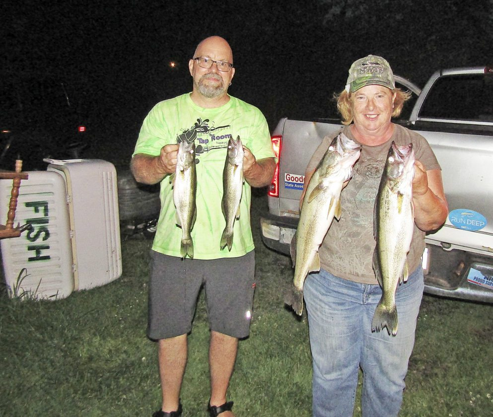 OBSERVER Photo by Gene Pauszek Ray Pauszek (left) and Ann Tofil display some nice walleye caught fishing on Wednesday evening in front of Dunkirk in 64 feet of water.