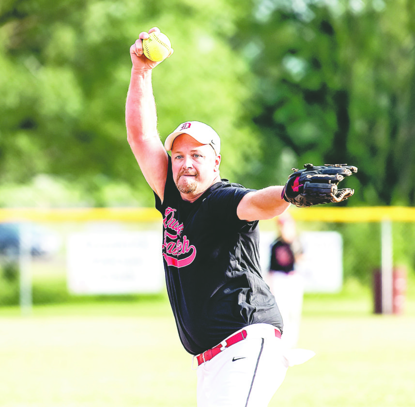 OBSERVER Photo by Ron Szot: Pictured is Tim Wdowiasz pitching in an afternoon game in yesterday's First Ward Fastpitch softball tournament.