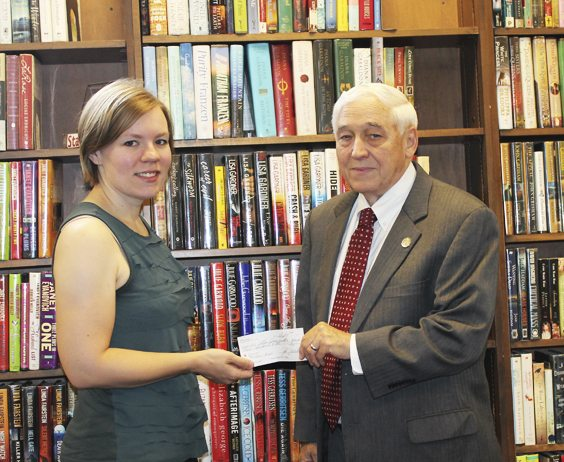 "Submitted Photo: Erie County Legislator John J. Mills, right, announced that the annual Hot Dog Roast Fundraiser benefitting the North Collins Library raised $910 for the branch. The money was donated during a presentation held Tuesday at the library with Kimberly Nobles, North Collins Library director. ""We're so grateful to Legislator Mills for his love of libraries and his desire to help us provide to the community. We hope to use the funds raised to provide programming this fall and winter,"" said Nobles. North Collins, which held its fundraiser on June 21, raised $910, bringing the library's six-year total to $6,141. The Hot Dog Roast Fundraisers have raised nearly $70,000 for the libraries in Mills' district. For information on the Hot Dog Roast Fundraisers, or to speak with Mills, contact his Legislative Office at 858-8850 or email john.mills@erie.gov."