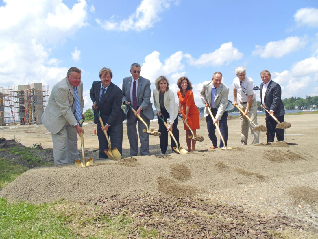 OBSERVER Photo by Jimmy McCarthy. Lt. Gov. Kathy Hochul gathered with local officials and developers Friday to mark the beginning of the Chautauqua Harbor Hotel in Celoron. Pictured from the left are Kevin Sanvidge, administrative director and CEO for the county Industrial Development Agency; Celoron Mayor Scott Schrecengost; County Executive Vince Horrigan; state Sen. Cathy Young, R-Olean; Hochul; Dave Hart, CEO of Hart Hotels; Assemblyman Andy Goodell, R-Jamestown; and Peter Krog, CEO of Krog Corp.