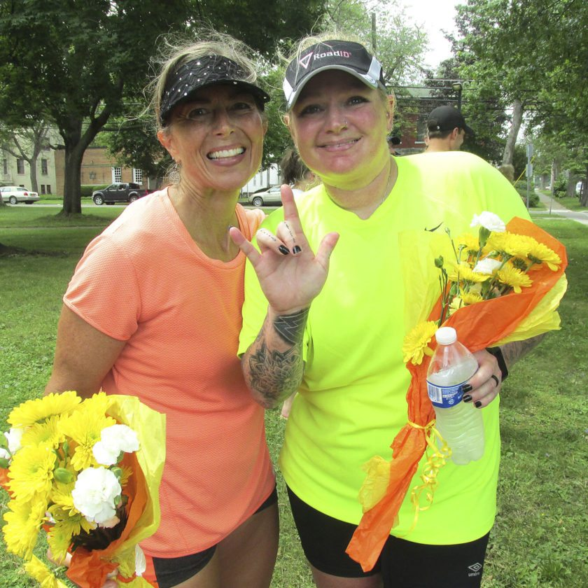 OBSERVER Photo by Damian Sebouhian. Lisa Glasier and Rose Carr ran nearly 30 miles from Jamestown to Dunkirk, raising nearly $800 for The Resource Center in the process.