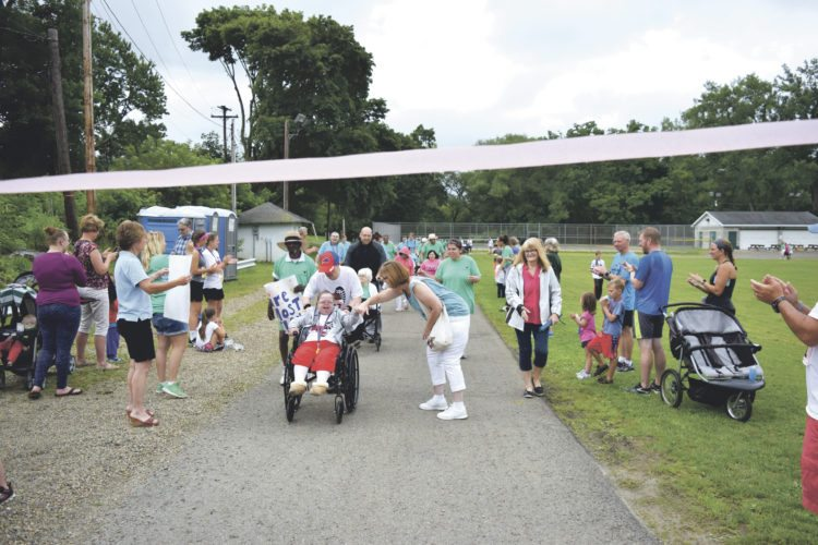 OBSERVER Photo by Andrew David Kuczkowski Laurel's Lap finished with many smiling faces as they crossed the finish line at Saturday's conclusion of Laurel Run XXI in the village of Silver Creek.