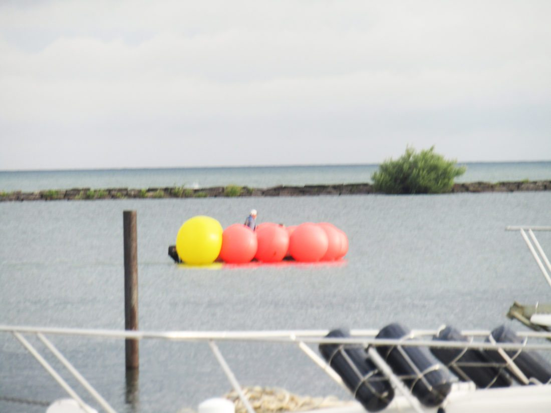 OBSERVER Photo by Gene Pauszek Birthday ballons? These were the marker buoys for the Air Show being towed into position by a boat.
