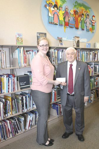 Submitted Photo. Erie County Legislator John J. Mills, right, presents a check to Collins Library Director Abigail Barten-McGowan.