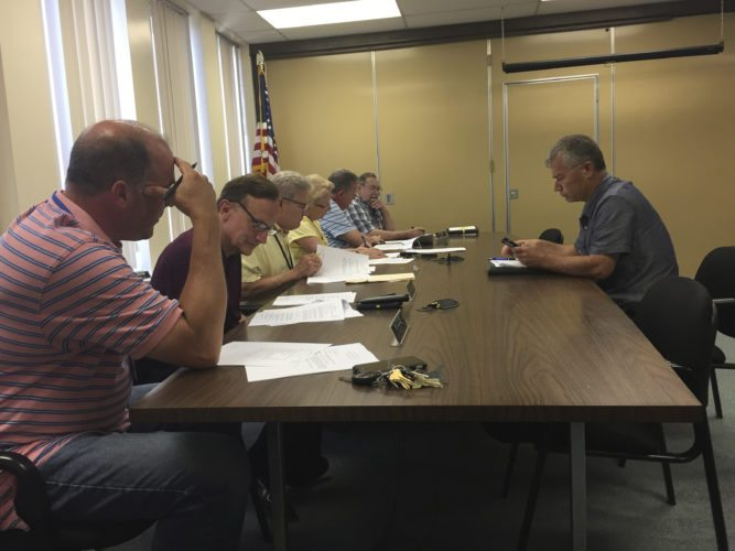 Photo by Jimmy McCarthy. Chautauqua County legislators approved two resolutions to accept federal funds for airport projects during Monday's Public Facilities meeting in Mayville. George Spanos, county public facilities director, briefly discusses the projects with committee members.