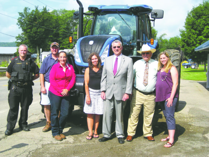 Photo by Jimmy McCarthy. Pictured from left to right: Mike Seeley, Chautauqua County Deputy Sheriff; Ed Faulkner, Clymer Fire Chief; Emily Reynolds, Executive Director of Cornell Cooperative Extension of Chautauqua County; Shelly Wells, Public Health Planner of the Chautauqua County Department of Health and Human Services; Vince Horrigan, Chautauqua County Executive; Pete James, Chautauqua County Traffic Safety Board member; and Bree Agett, Epidemiology Manager of the Chautauqua County Department of Health and Human Services.