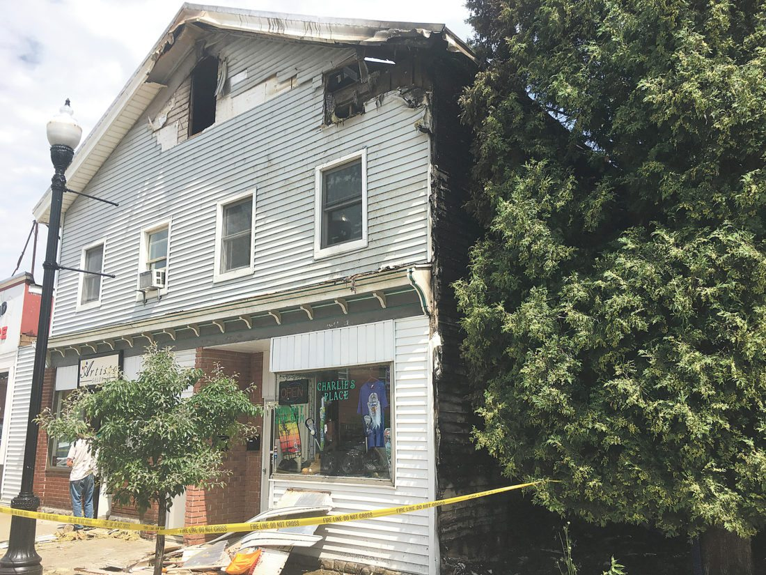 OBSERVER Photo by Andrew David Kuczkowski No, it's not shade that is darkening the south side of the pictured building, 21 Jamestown St., Gowanda. That wall is the result of an ongoing arson case from Tuesday's fire in the village that caused the building to be a total loss, around $200,000.