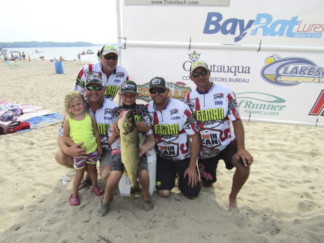 OBSERVER Photo by Gene Pauszek: First Place finish for Big Fish Friday was the Sleeman team Midnight Express with a 10.04 pound walleye. From left, in front: Annie, Ethan, Fisher and Craig Sleeman. Back row: Mark Outhouse and Matt Reber. Sleeman took first place in 2016 as well.