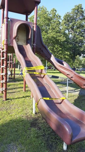 OBSERVER Photo by Nicole Gugino: One of the larger slides at Point Gratiot is out of commission, according to Dunkirk Mayor Willie Rosas, due to a large crack. The slide has been blocked off and caution tape wrapped around to discourage use until a new replacement slide is delivered and installed. Rosas said the slide was still under warranty. Parents are asked to keep their children off the slide until it is replaced and reopened.