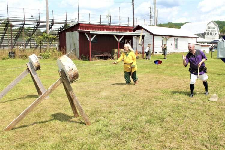 "Photos by Jordan Patterson: David Sally and Brain Newman practice throwing knives and axes at targets inside the ""Viking Village,"" during the Scandinavian Folk Festival in Gerry."
