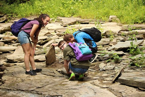 Submitted Photo The Jamestown and Warren Kiwanis Clubs support outdoor adventures by providing funds for camperships to Audubon Community Nature Center summer day camps. The campers pictured here discovered life under a rock earlier this month at Teen Trek Camp.