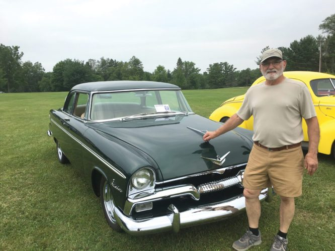 OBSERVER by Andrew David Kuczkowski Pictured is Ernie Colantino with his first-place winning 1955 Plymouth at the Collins Center Car Show on Saturday at the town park.