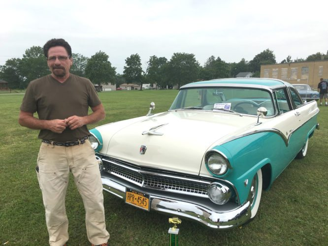 OBSERVER by Andrew David Kuczkowski Pictured is Jeff Jackson with his second-place winning 1955 Ford Crown Victoria at the Collins Center Car Show on Saturday at the town park. For complete coverage from Saturday's event see page A3.