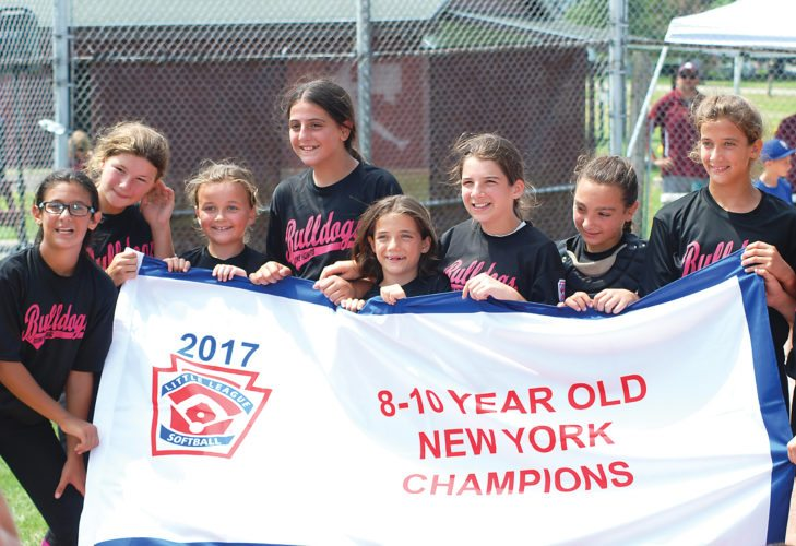 OBSERVER Photos by Jared Hill Pictured are scenes from Saturday's 8-10 year old New York state softball championship game held at Joe Karnes Field at Wright Park in Dunkirk.