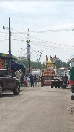 OBSERVER Photo by Amanda Dedie The midway was packed with food trailers, rides and people Sunday, working hard to get the Chautauqua County Fair ready for today.