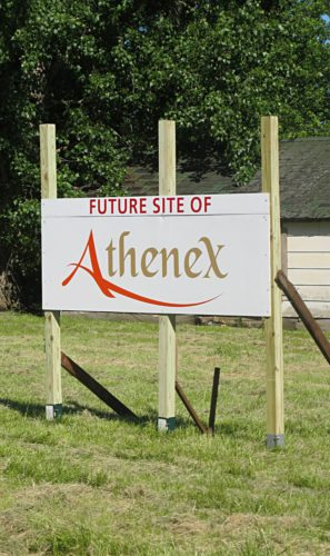 OBSERVER File Photo Soon, the 32 acres of land behind this sign at the future Athenex site will be cleared out and shovel ready.