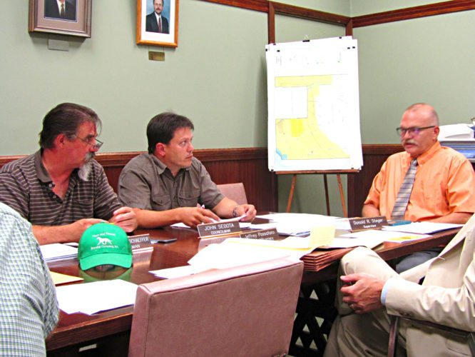 OBSERVER Photo by Greg Fox The Pomfret Town Board recently voted, 3-2, to decrease the minimum quarterly usage amount from 10,000 gallons to 5,000 gallons for water districts supplied by Fredonia as a way to raise needed revenue. Pictured, from left: Councilmen Christopher Schaeffer and John Sedota and Supervisor Donald Steger.