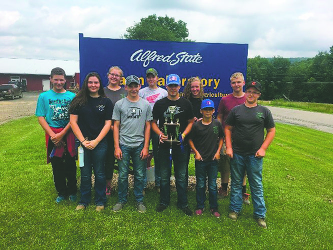 Submitted Photo Ten 4-H youth from Chautauqua County, NY excelled in the Finger Lakes District Dairy Judging contest held at Alfred State College Farm and proudly show their ribbons and trophy received for their efforts.
