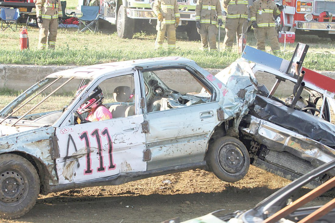 OBSERVER Photo by Lisa Monacelli Emily Dillenburg, of Forestville, in car A111, is seen causing some damage in the A Heat of Tuesday's Chautauqua County Fair Demolition Derby. Dillenburg was one of the winners of that heat and moved on to Sunday's championships.