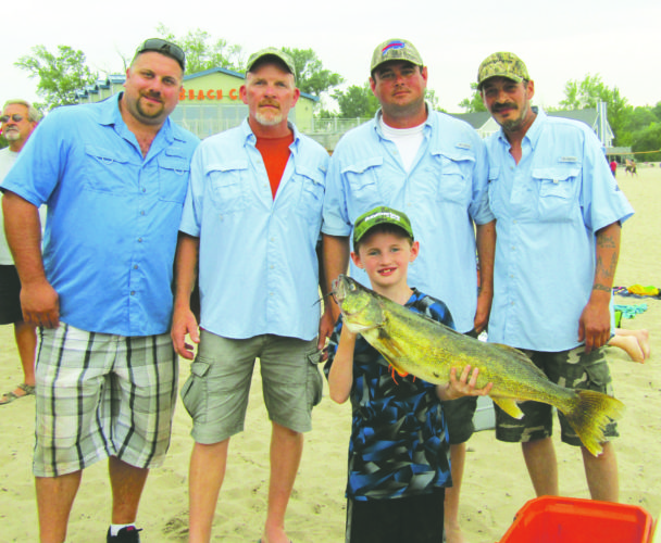 OBSERVER Photo by Gene Pauszek Team Dances with Fish: Jeff Caparco, Rich Eggleston, Ron Duliba Jr. and Jason Biffaro, caught the second heaviest walleye during the Sunset Bay Shoot out last Saturday, weighing 9.33 pounds, held by William Duliba.