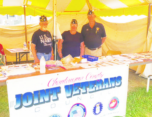 Allen Crick of the Falconer American Legion, left, Rebecca Martel of the Brocton Legion and Jack Hood of the Dunkirk American Legion stand ready to help veterans.