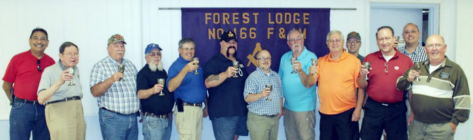 Submitted Photo Members of Forest Lodge No. 166 toast the 300th anniversary of the founding of organized Freemasonry in London, on June 24, 1717.
