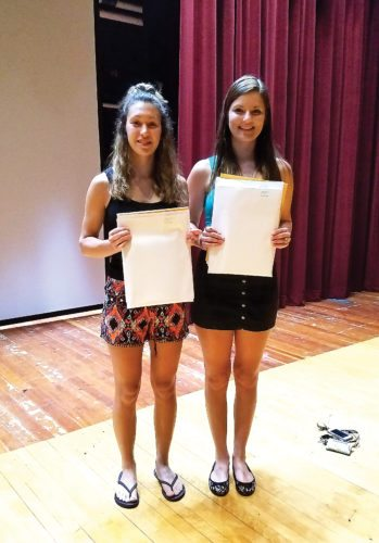 """Pictured above are Sydnee Abele (left) and Maddison Knapp, two student-athletes who've achieved this honor for five years in a row. Westfield held their yearly Scholar Athlete/Sportsmanship Awards Banquet on June 19. The following 19 student athletes earned their Westfield Scholar Athlete Award. The recipient must be an active member in good standing for three sports and maintained a quarterly average of 90 or above in each season: Sydnee Abele, Hayden Backus, Owen Bates, Katie Bodenmiller, Austin Bourgeois, Sophia DeMarco, Sophie Devlin, Cooper Harris, Ryan Jafarjian, Jasmine Kiswani, Maddison Knapp, Madeline Lancaster, Nicholas Presto, Dylan Scriven, Darien Swanson, Abigail Warner, James Wolfe, John Wolfe, McKenzie Wolfe, Susanna Wolfe. Very special thanks to Mr. Henry """"Hank"""" Lynn, who has served as the Volunteer Athletic Awards Coordinator for the past 15 years since he retired from Westfield as a Teacher/Coach/Athletic Director in 2002. Mr. Lynn has 52 total years of service to the District and he will be greatly missed."""